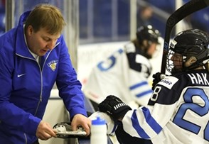 PLYMOUTH, MICHIGAN - APRIL 1: Finland's Sanni Hakala #28 has her skate sharpened by Finland equipment manager Hemmo Jara prior to preliminary round action against Canada at the 2017 IIHF Ice Hockey Women's World Championship. (Photo by Matt Zambonin/HHOF-IIHF Images)