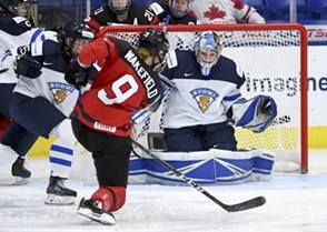 PLYMOUTH, MICHIGAN - APRIL 6: Canada's Jennifer Wakefield #9 with a scoring chance against Finland's Noora Raty #41 during semifinal round action at the 2017 IIHF Ice Hockey Women's World Championship. (Photo by Matt Zambonin/HHOF-IIHF Images)